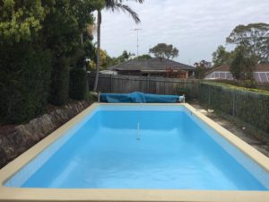domestic-pool-in-baulkham-hills-repainted-with-luxapool-epoxy-in-pacific-blue-and-coping-painted-with-luxapool-poolside-and-paving-in-riversand