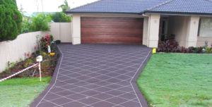 Patterned driveway with concrete sealer